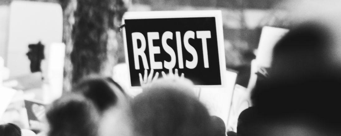 https://www.pexels.com/photo/monochrome-photo-of-resist-signage-3141240/