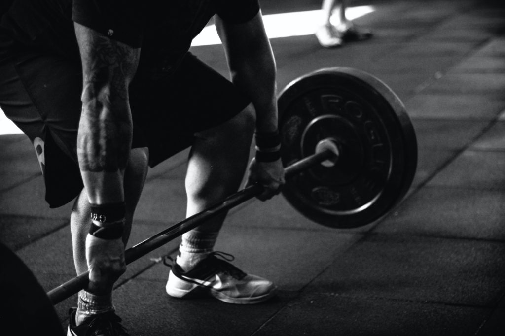 Man preparing to lift barbell