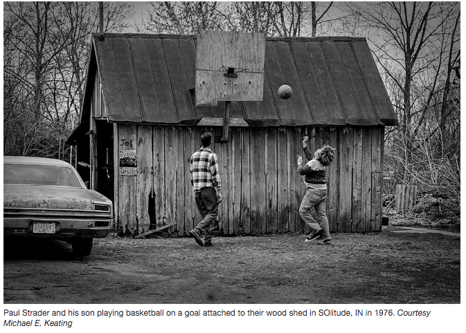 father and son playing basketball on wood shed in Indiana