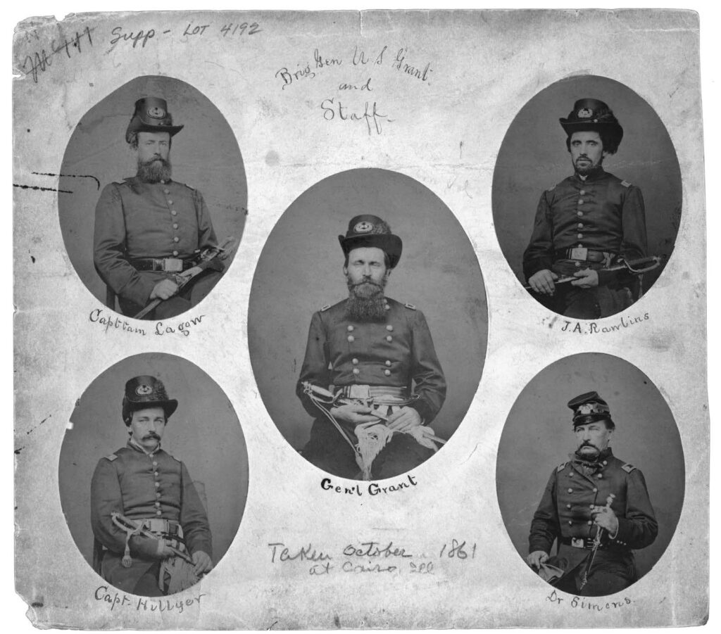 Grant and Staff in Cairo, IL, October 1861. Surrounding Grant, clockwise from top left: Clark Lagow, John Rawlins, William Hillyer, and Dr. James Simons.  Library of Congress Prints and Photographs Division, Washington, DC.