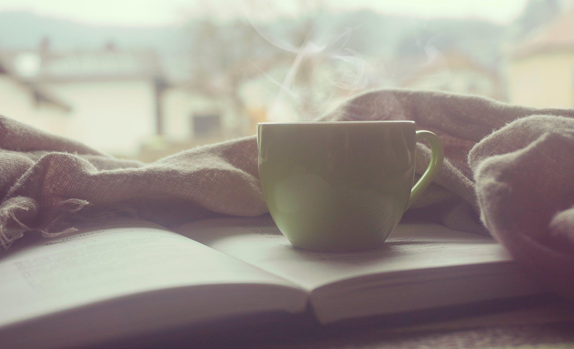 coffee cup notebook pen